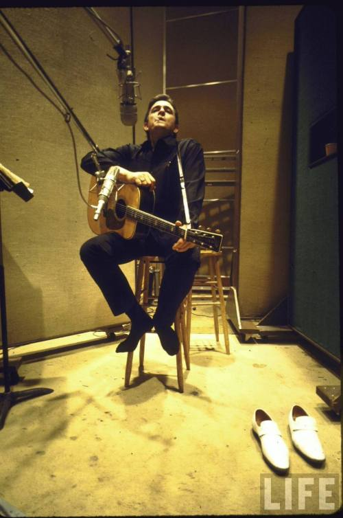 Country/Western singer Johnny Cash in recording studio.  Nashville, TN 1969