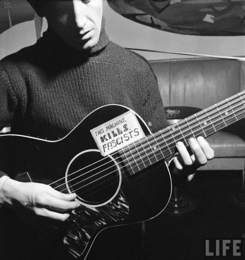 Woody Guthrie- the sign says it all.   New York, 1943.