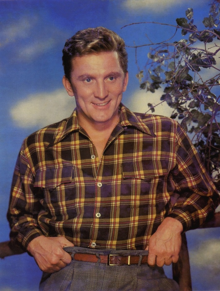 "Kirk Douglas.  Pattern mixing was big for Fall, with guys everywhere layering tartans and buffalo checks-- but beyond the ""in your face"" look is the subtle art of the gentleman who can do it with a much more subtle and dapper affect."