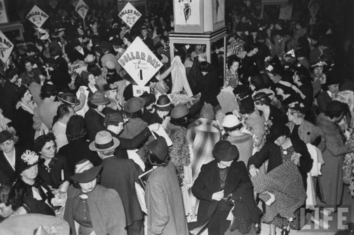 Mauling mass of female shoppers ravaging the misses dress counters of Filene's basement during semi-annual, one price for all, Dollar Day sale which racks up dress sales of $45,000. --Boston, MA 1938