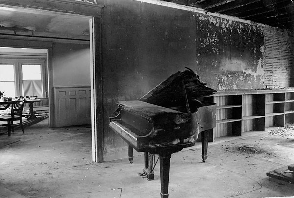 Ms. Quinn says that when she pressed a key on this piano in the living room, the whole thing collapsed and fell through the floor.