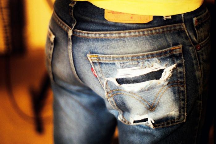 ripped torn faded levi 501 denim jean