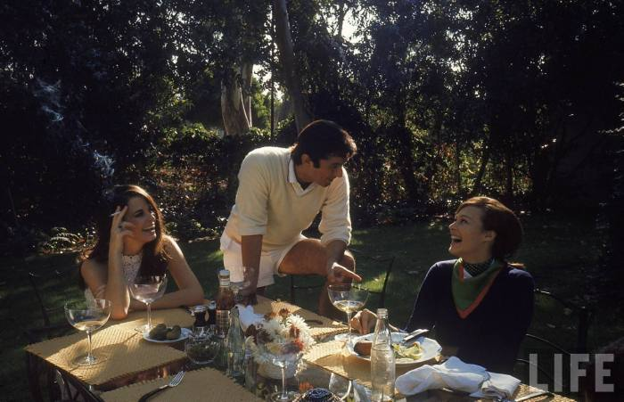 Film director Robert Evans having lunch at home with live-in girlfriend Libby Boehmer-- Beverly Hills, CA 1968.