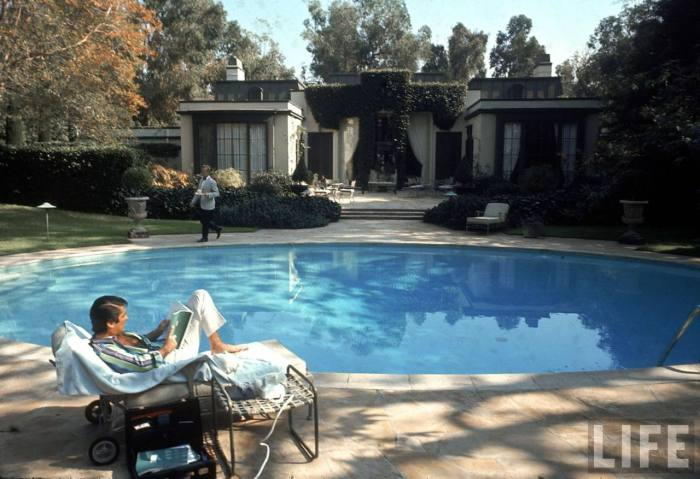 Film director Robert Evans at poolside in backyard of his home-- Beverly Hills, CA 1968.