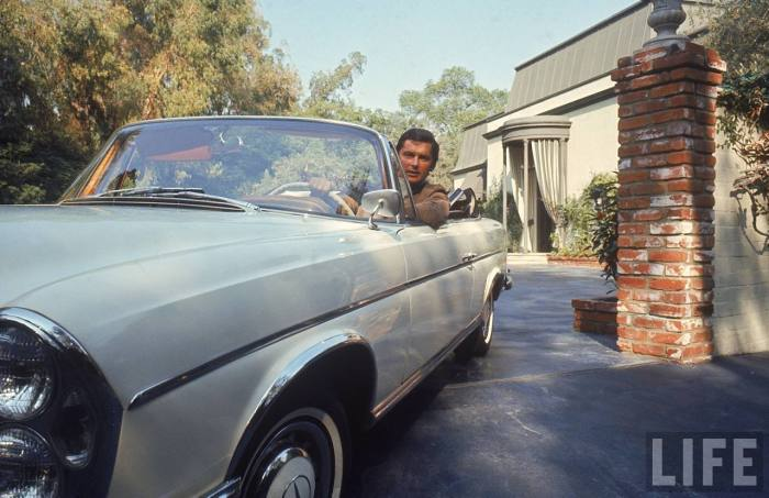 VP of Paramount Pictures Robert Evans leaving home in his Mercedes Benz convertible-- Beverly Hills, CA 1968..