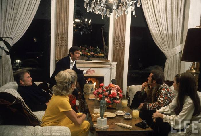 Actor Kirk Douglas, film director Robert Evans, actor Tony Curtis and their wives at Evan's home-- Beverly Hills, CA 1968.