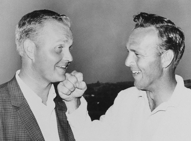 Jun 1962, Oakmont, Pennsylvania, USA --- Oakmont, Pa.: Arnold Palmer playfully punches the chin of Jack Nicklaus after Nicklaus won the U.S. Open at the Oakmont Country Club in an extra day playoff round--  June 1962.