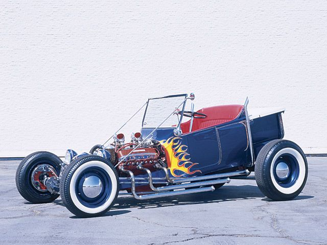 The Legendary Norm Grabowski Kookie Kar.  Paint by Valley Custom with flame job and pinstriping by Dean Jeffries.  Tony Nancy stitched up the rolled and pleated red interior.