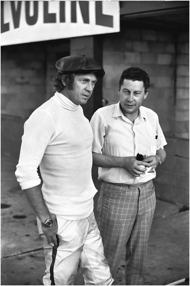 Steve McQueen with a journalist in the pit area at the 1970 Sebring 12 Hours.