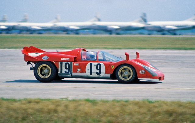 Mario Andretti in his Ferrari 512S Spyder at the 1970 12 Hours of Sebring. This car led most of the race and retired with gearbox problems 21 laps from the finish allowing the Porsche 908 of Steve McQueen and Peter Revson to take the lead. Andretti jumped to the #21 team Ferrari 512S to eventually win the race by 22 seconds. Reason: The 512 had a V12 4994 cc engine while the Porsche had a V8 with only 2997 cc's. Remarkable that the Porsche came in second. Andretti thinks that McQueen's co-driver Peter Revson was the reason the car remained competitive for the whole race. According to Andretti, Revson drove 8 of the 12 hours.  --Nigel Smuckatelli
