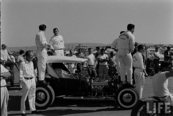 The Road Kings, with Tommy Ivo standing at far left, seem ready for another pass at the Santa Ana Drags. The car appears much as it does today, with Hilborn fuel injection, race slicks, Mercury hubcaps, and full top.