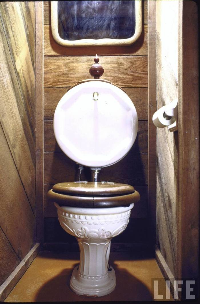 Antique toilet with wooden seat found at a garage sale now in home of art director John Holmes, which is made entirely from used parts.