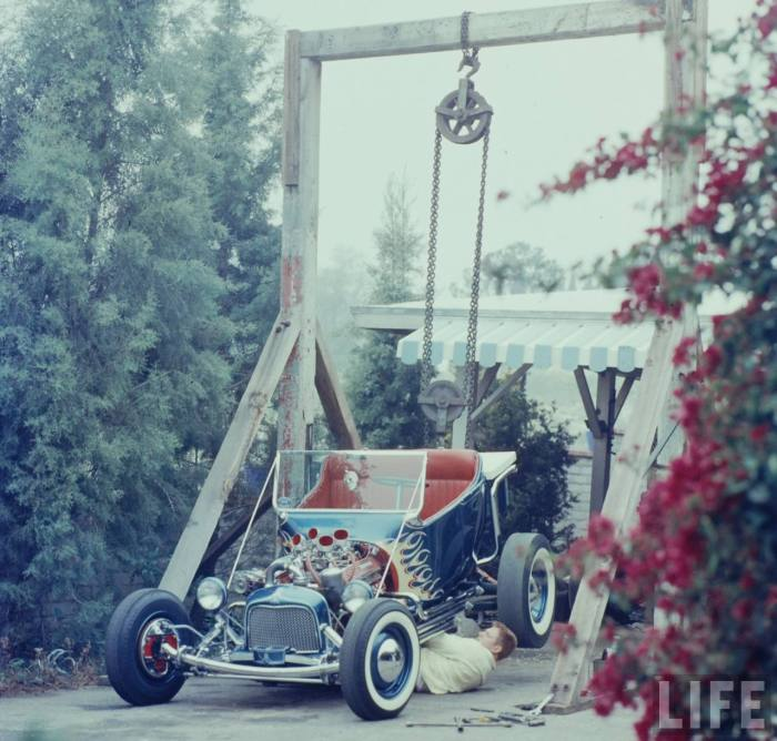 Norm Grabowski working under his Kookie Kar with a homemade hoist-- around '57 - '59 in Sunland, CA.