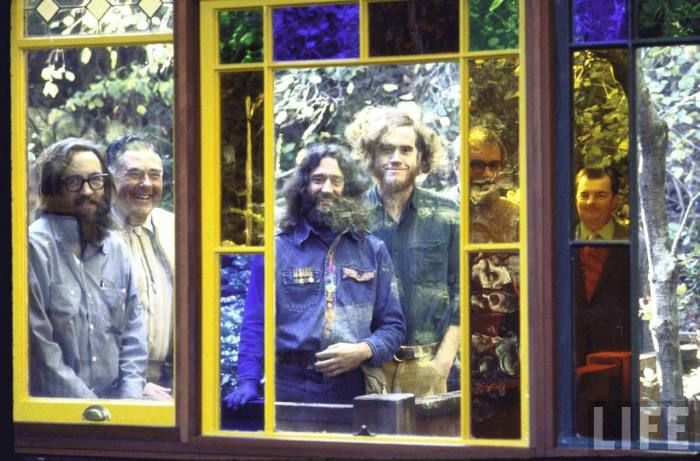 (L-R) contractor Don Umphrees, building inspector Henry Anderson, Kirsch, Holmes, civil engineer Edward Beattie and mechanical engineer Robert Ritter standingin stained glass doorway.