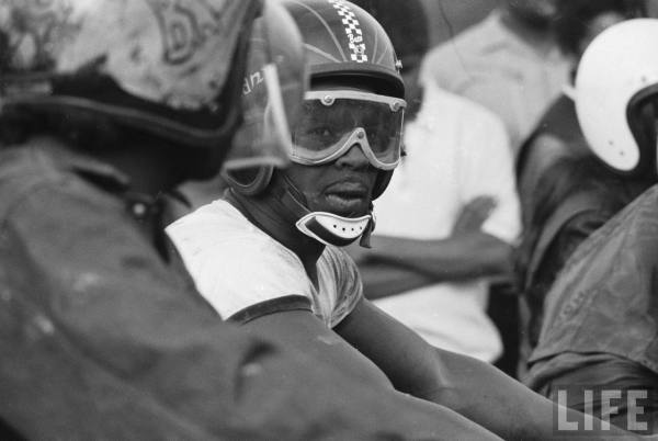 African American motorcycle enthusiast belonging to the Big Circle Motorcycle Association prepares to ride-- circa 1971.
