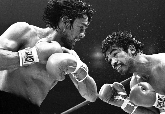 Boxing great Robert Duran (left).