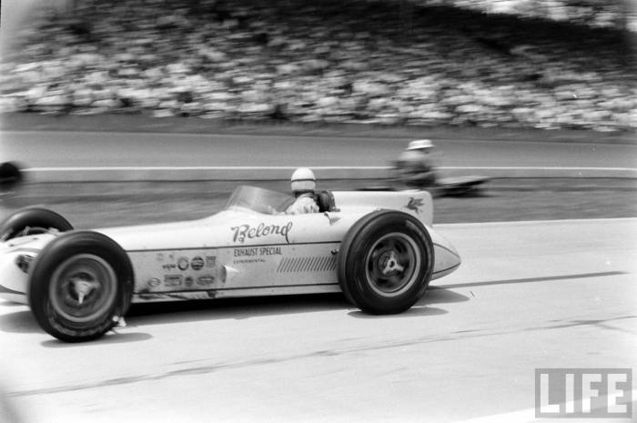 Sam Hanks at work behind the wheel of the horizontally mounted engine roadster in 1957's Indy 500.