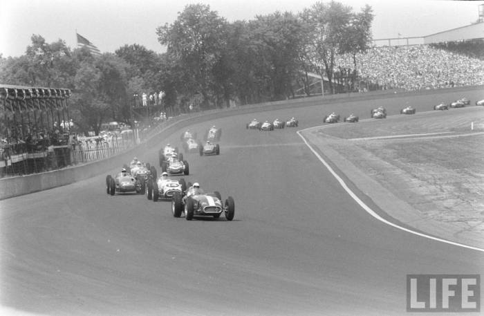 Taking the turn at over 130 mph at the 1957 Indy 500.