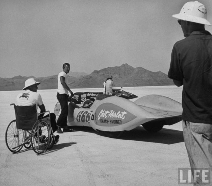 Chet Herbert, a paraplegic, supervising while a man prepares to start his car at Bonneville-- September, 1953.