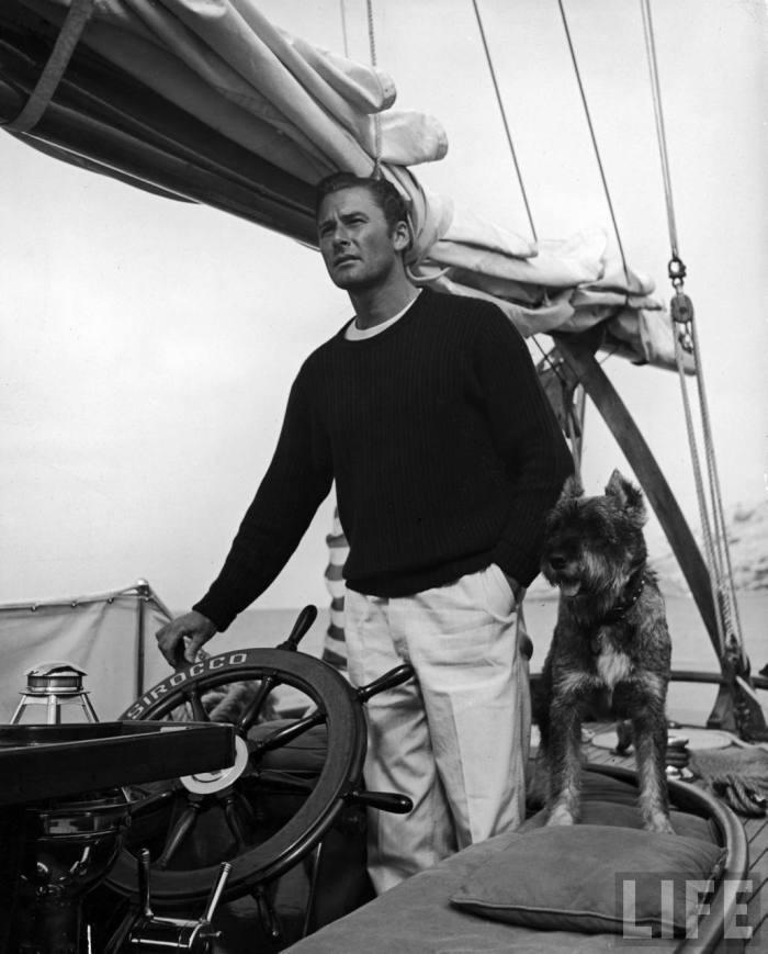 Errol Flynn in flat front trousers.