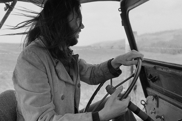 Neil Young driving an old Jeep on his Broken Arrow Ranch --- Image by Henry Diltz