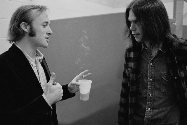 12 Jul 1970-- Stephen Stills and Neil Young hanging out backstage. -- Image by © Henry Diltz