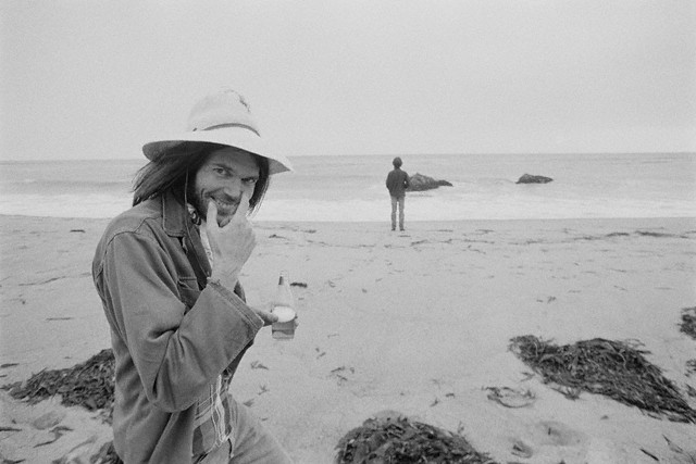 Malibu, 1975 ---  Neil Young enjoying a stroll on the Beach --- Image by © Henry Diltz