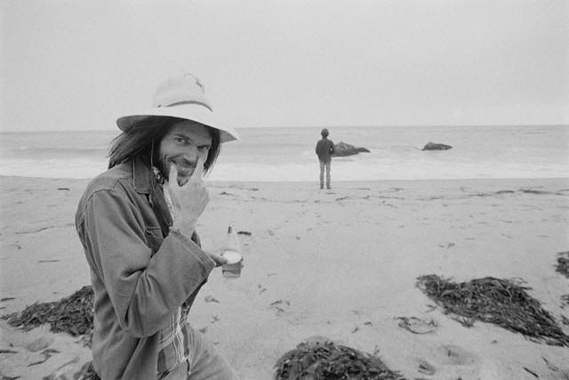 Malibu, 1975 ---  Neil Young enjoying a stroll on the Beach --- Image by © Henry Diltz