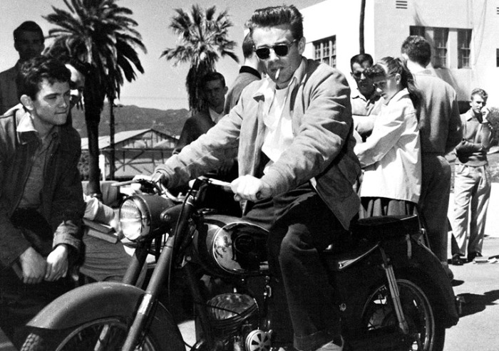 "James Dean on the set of ""Rebel Without a Cause"" astride his Triumph T5 Trophy."