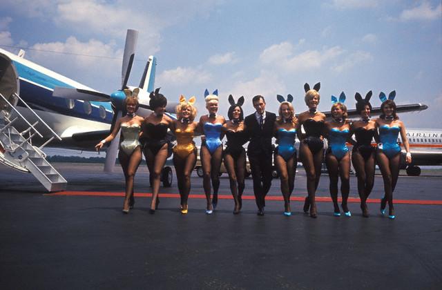 Hugh Hefner jet-setting with his Playboy Bunnies.
