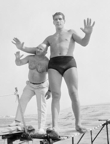 31 Jul 1967, French Riviera, France --- Famous French wrestlers, (L) Cheri-Bibi and (R) Andre Roussimoff, best known as Andre the Giant. At 19, Andre stands 7 feet and 4 inches tall.