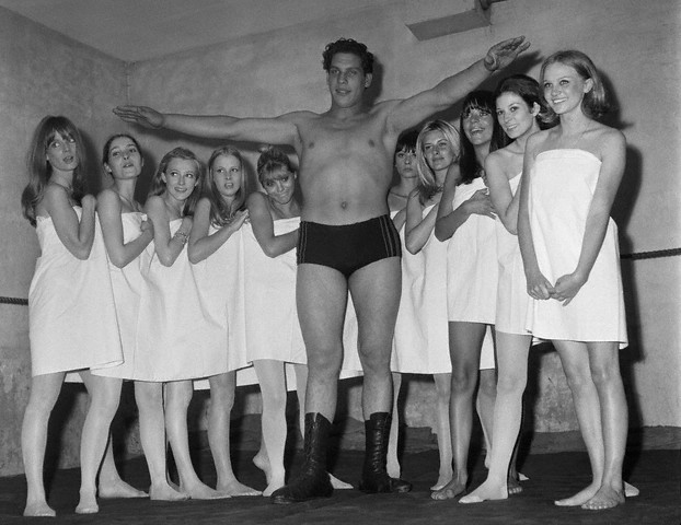 "French wrestler Andre Rene Roussimoff, best known as ""Andre the Giant"" during a Paris fashion exhibition. At 19, Andre reportedly stands 7 feet and 4 inches tall  --1966."