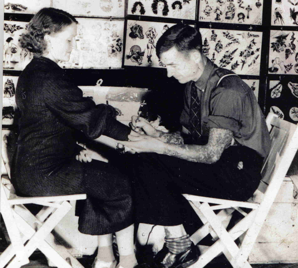Franklin Paul Rogers tattooing his wife, Helen-- circa 1936.