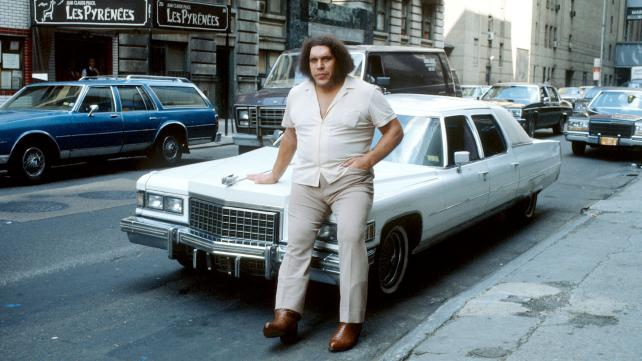 andre the giant sitting on car