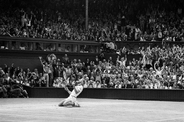 Bjorn Borg falls to knees after defeating John McEnroe 7-5, 6-3, 8-6, to win the Wimbledon title for the 5th consecutive year, 1976-1980.