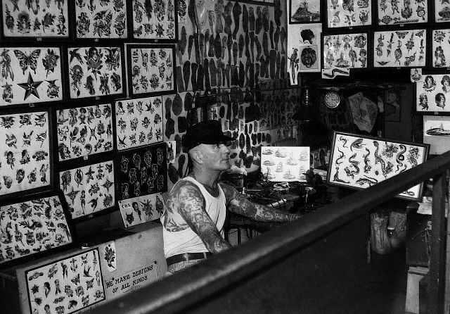 """August ""Cap"" Coleman personally manned his legendary tattoo parlor six days a week."