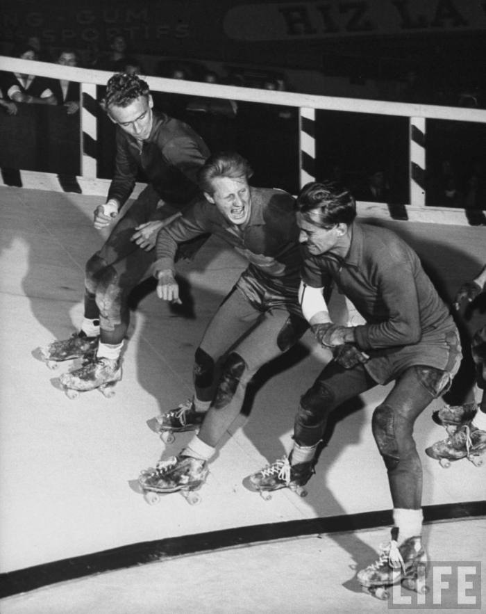 "Roller Skating Derby, American team vs phony ""European"" team, also American, Roger Schroeder gets elbowing by Americans for carrying Swedish flag.  Paris, France  --1953."