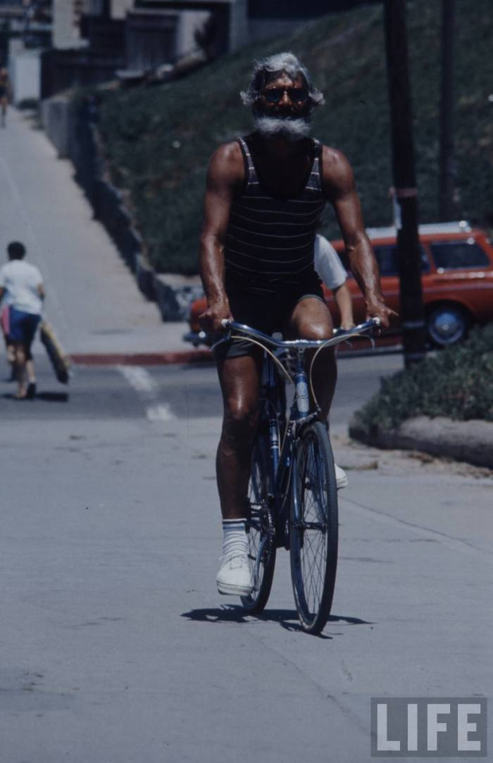 Facial hair folly-- stayin' fit and tan aboard his bike.