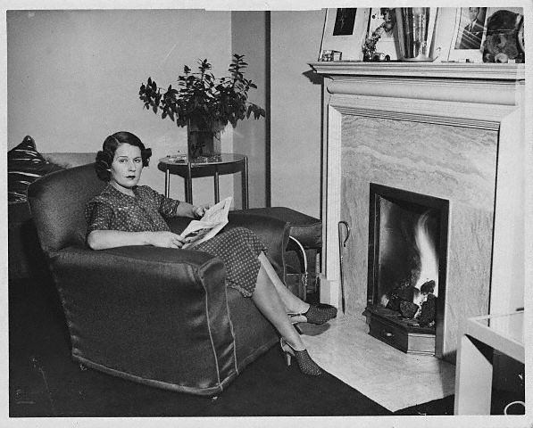 Kay Petre, the racing legend, recovers at her London home after an accident at Brooklands, ca. 1938.
