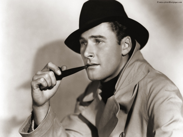 The always suave, Errol Flynn smoking in style.