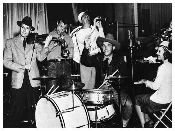 Jack Benny, Dick Powell, Ken Murray, Bing Crosby on drums, Shirley Ross.