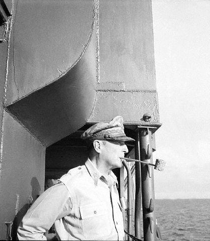 General Douglas MacArthur, smoking his familiar corncob pipe during a recent visit to Cebu.  Photo by Dave Davis, Acme photographer for the war picture pool  --25 Jun 1945, Cebu.