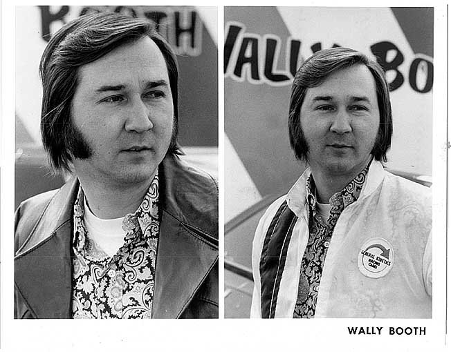 Wally booth, ca. 1970s.  That hair is outta sight, man.  Great style all around -- love the paisley printed shirt.
