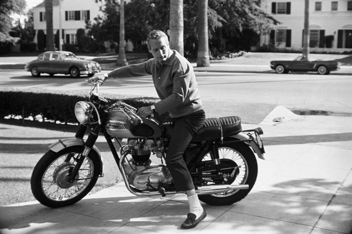 Paul Newman on his Triumph motorcycle at home, 1965. photo  © David Sutton