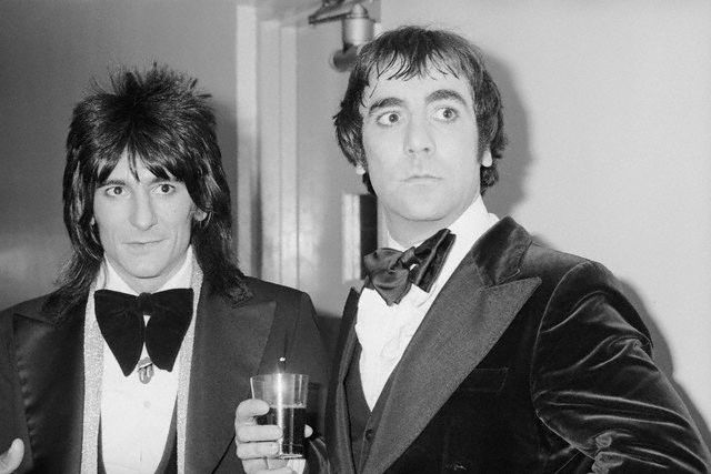 Ron Wood of the Rolling Stones and Keith Moon of The Who, backstage at the 1977 American Music Awards.