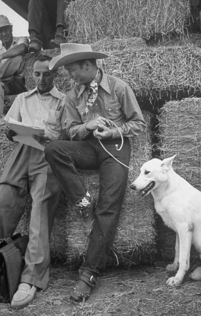 "Actor Roy Rogers & his dog ""Phantom talking to his agent during break in filming on the Republic Pictures movie lot.  Hollywood, ca. 1939."