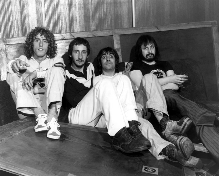 Roger Daltrey, Peter Townshend, Keith Moon, and John Entwistle of The Who.  Check out Moon's crazy stacked platform heels.