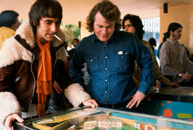"Keith Moon playing pinball at the International Pinball Tournament, an event coinciding with the opening of the group's rock opera ""Tommy"", ca. 1978."