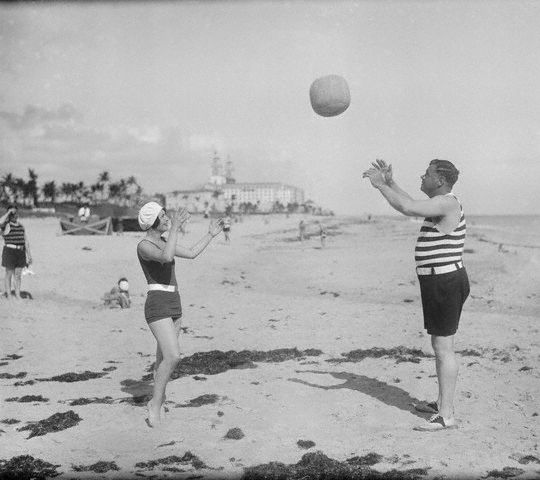 Original caption -- Hurling the sphere! The wife of the King of Swat, Babe Ruth, is aiding him in rounding into pre-spring training condition, by throwing the medicine ball on the sands of Sea Spray Beach, Palm Springs, Florida. The Bam looks pretty natty in a bathing suit. -- Jan. 30th, 1930.