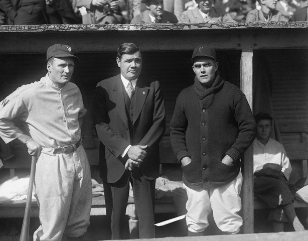 Babe Ruth with baseball players, Walter Johnson and Babe Adams, during the World Series of 1925.